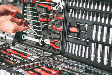 Fototapeta Hardware showcase. Cropped shot of repairman choosing screwdriver in tool store. obraz