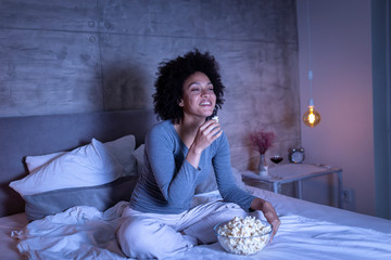Woman watching a funny movie on TV