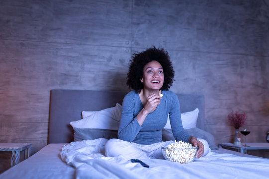 Woman watching comedy on TV