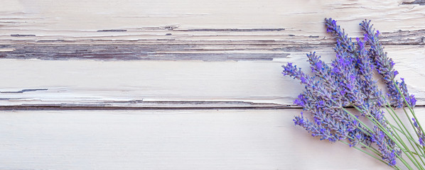 Tuinposter Lavendel Summertime - lavender flowers. Bunch of lavender flowers on white rustic wooden background.