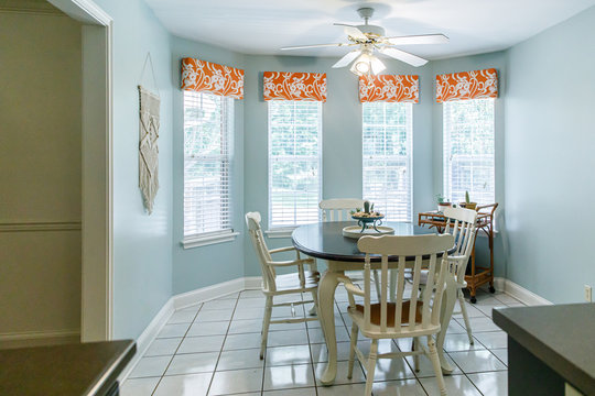 Light Blue Eat-In Dining Room next to the kitchen with a tile floor, table and chairs