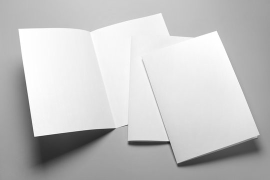 Blank half-folded booklet, postcard, flyer or brochure mockup template on gray background