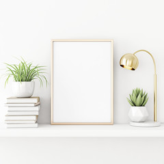 Interior poster mockup with vertical gold metal frame standing on the table with succulent plant, lamp and pile of books on empty white wall background. 3D rendering, illustration.