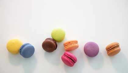 Fotobehang Macarons Colorful macarons on white background, close up view