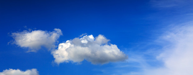 Clouds and blue sky background with copy space.