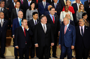 U.S. Secretary of State Mike Pompeo poses in a family photo with participants of the Ministerial to Advance Religious Freedom in Dean Acheson Auditorium at the State Department in Washington