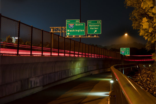Traffic Exit Sign to National Harbor in Maryland at Night