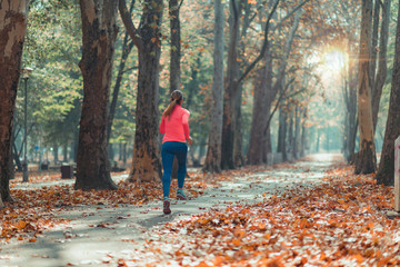 Woman Jogging Outdoors in Park Wall mural