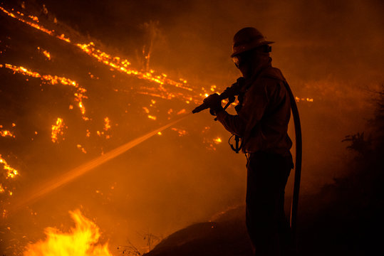 Silhouette of wildland firefighter in action