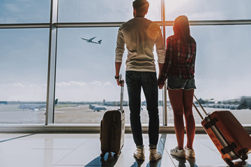 Wall Mural - Young couple is going on honeymoon together