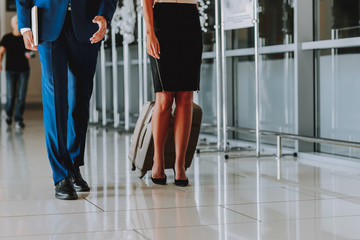 Wall Mural - Man and woman are returning from business trip