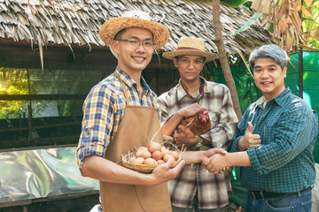 Businessmen join hands with farmers who do chicken farming, because the negotiation of trading products from farms is successful, to farmer concept.