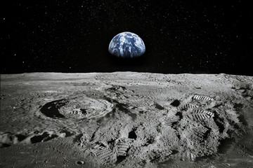 View of Moon limb with Earth rising on the horizon. Footprints as an evidence of people being there or great forgery. Collage. Elements of this image furnished by NASA. Wall mural
