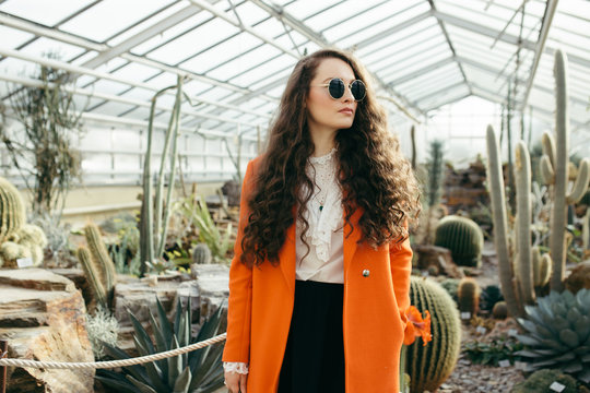 Portrait of a woman in a botanical garden