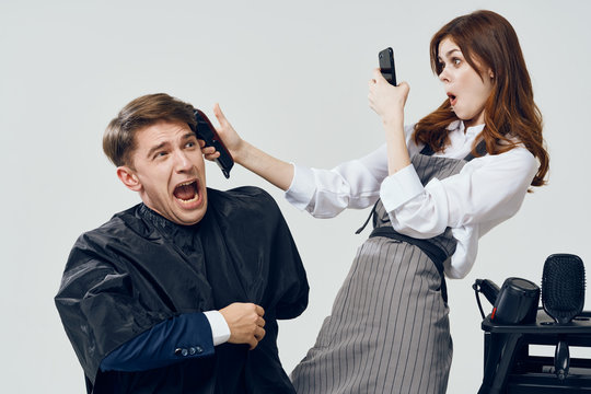 man and woman fighting over white background