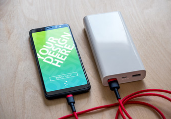 Smartphone Plugged into Portable Charger Mockup