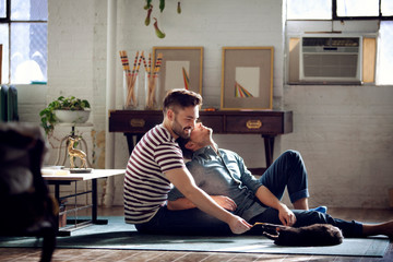 Couple relaxing on floor in living room