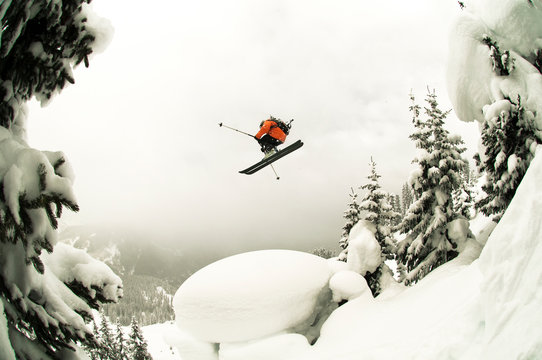 Skier jumping off mountain