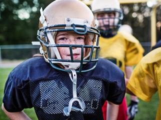 Portrait of boy playing American football