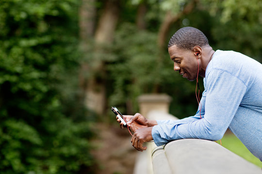 Man using snartphone in park