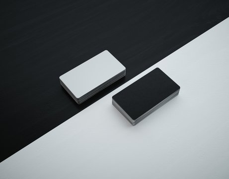 Mockup business cards of 5 cm x 9 cm. White face and black back. Rounded corners.