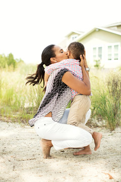 Woman kissing her son (2-3) on cheek