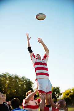 Rugby player catching ball outdoors