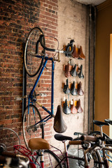 Old-fashioned bicycle attached to wall