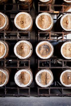 Beer barrels on rack in beerhouse