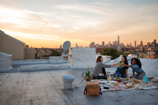 Friends enjoying picnic on rooftop