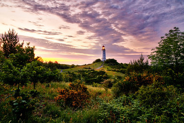 lighthouse in summertime sunset