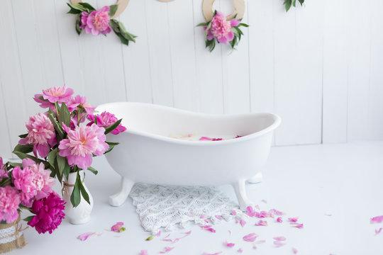 baby bath and peony flowers. pink peonies. children's bath
