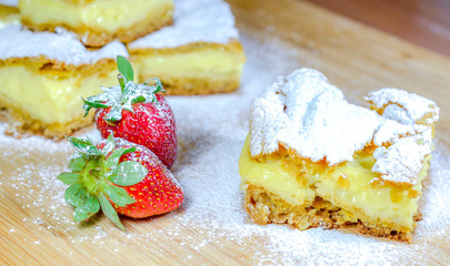 French cuisine .Custard cake on a wooden background.