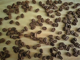 coffee beans on wood texture for background or wallpaper