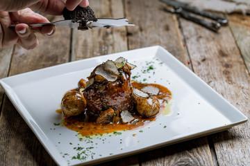 Fototapeta filet Mignon with truffle on white plate on wooden background obraz
