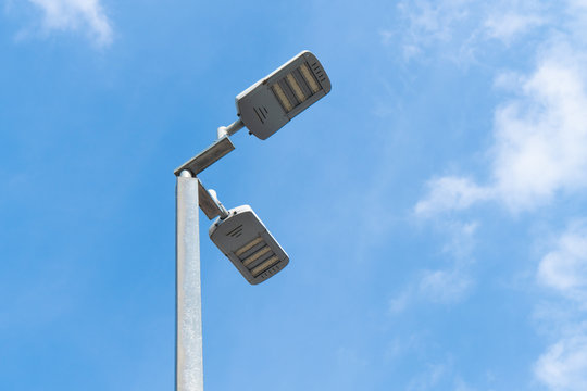 Street light with blue sky.