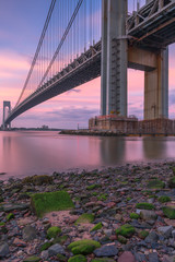 Verrazano-Narrows bridge from the beach at sunset with long exposure