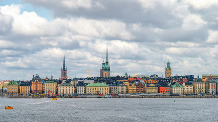 Poster Stockholm Scenic view on Gamla Stan (Old town) in Stockholm from Strommen bay, Sweden, at cloudy spring day.