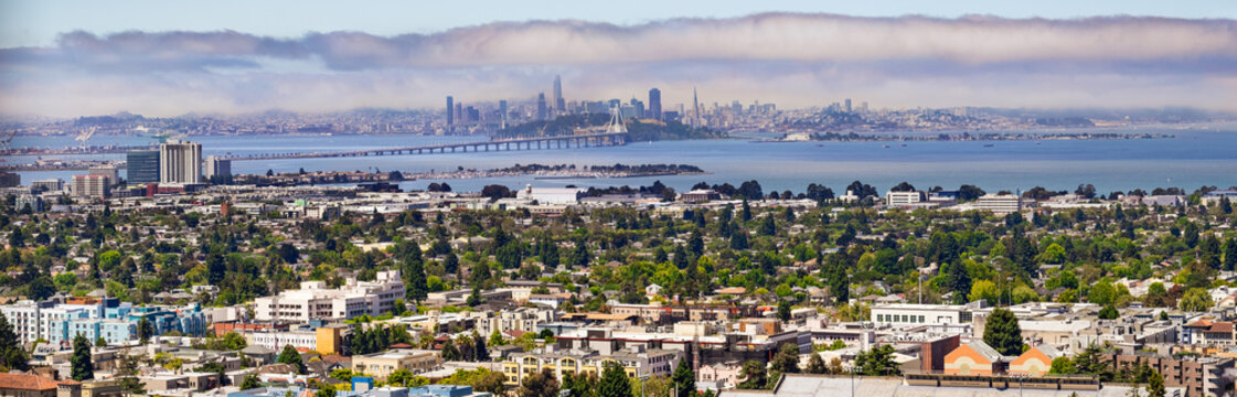 Panoramic view of Berkeley; San Francisco, Treasure Island and the Bay bridge visible in the background; California