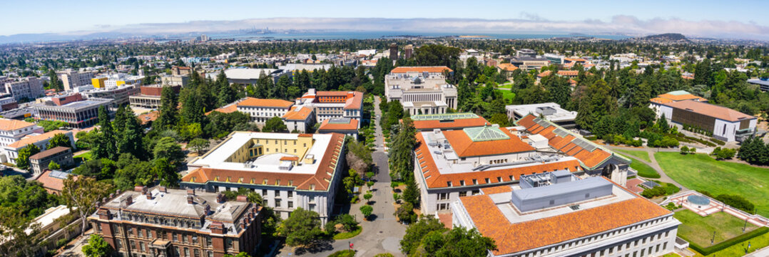 Panoramic view of the University of California, Berkeley campus on a sunny day; San Francisco, Treasure Island and the Bay bridge visible in the background; California