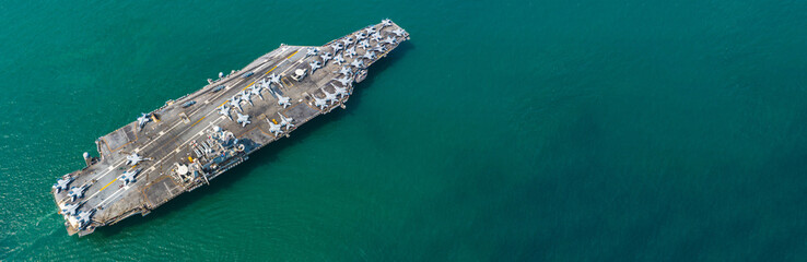 Aerial view Navy Nuclear Aircraft carrier, Military navy ship carrier full loading fighter jet aircraft with copy space. Fototapete