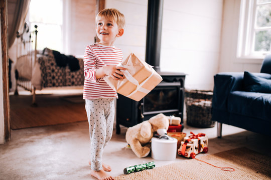 Little boy happy smiling with Christmas present
