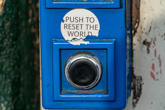 push to reset world button