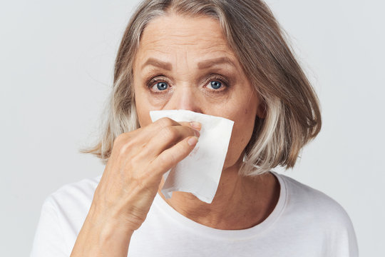 portrait of a woman with a runny nose