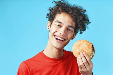young man with hamburger