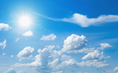 blue sky with white cloud and sun Wall mural