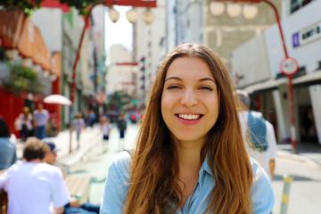 Happy beautiful smiling girl walking in Sao Paulo japanese neighborhood Liberdade, Sao Paulo, Brazil