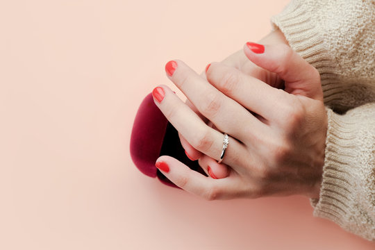 Young woman puts on finger ring for engagement.  Female hands closeup. Wedding and engagement concept. Offer to get married.