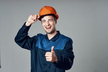 joyful man in an orange helmet