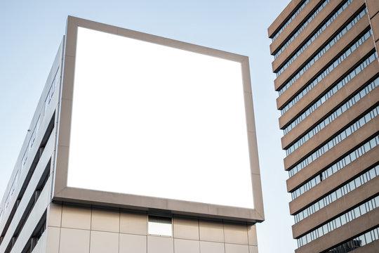Blank billboard mockup for advertising on a building facade